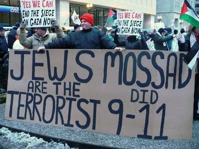 Sign held by protesters saying Jews are the Terrorist behind 9-11