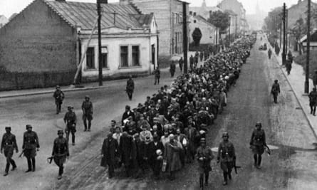 Jews being marched off to forced labor